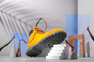 Werbung im Internet mit Schuhkonzept mit gelbem Stiefel und Treppenstufen.